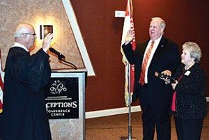 Judge Ringland swearing in Commissioner Humphrey with his wife Janice holding the Bible