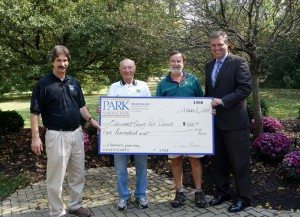 Chris Clingman, left, Director of Clermont Park District; Ken Stewart and David Anspach, board members; and Park National Bank Southwest President David Gooch.