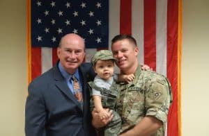 Commissioner Proud with Sgt. Joshua Kasten and his son, Blake, during a recognition at Session in August 2016.